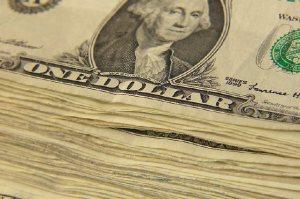 Stack of dollar bills uid